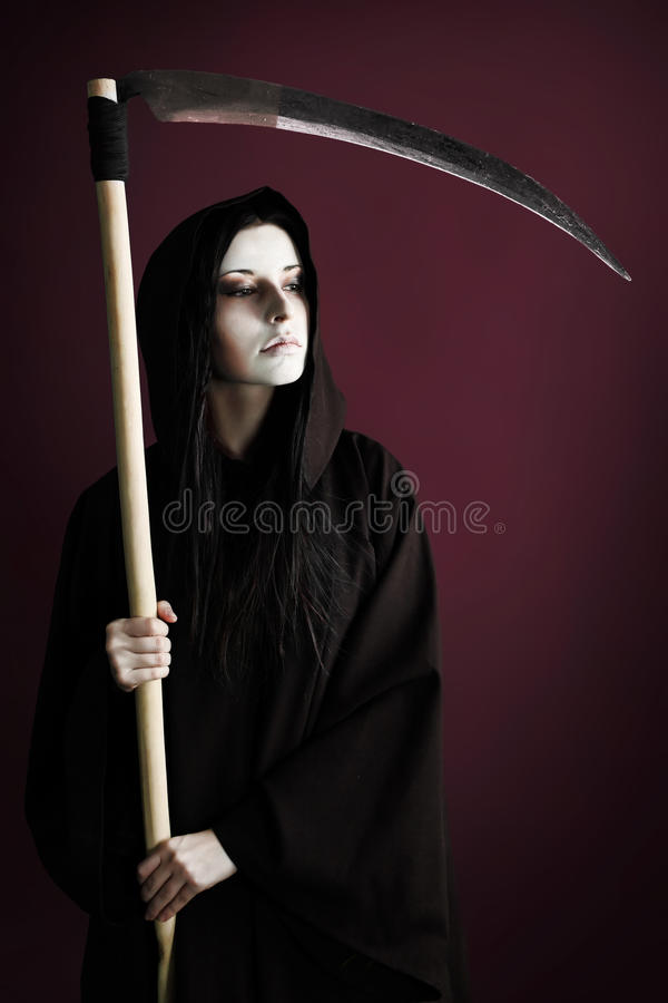 Horror. Woman death reaper over black background. Halloween stock images