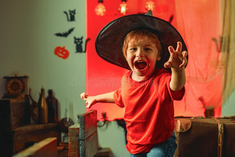 Horror face. Secrets of Magic for Happy Halloween. Halloween kids party and funny Pumpkin. Funny boy. stock photo