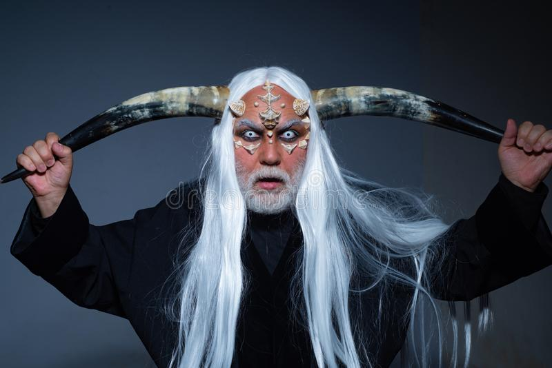 Horror and fantasy concept. Tree spirit and fantasy concept. Monster with white blue eyes. Magic and fairy tale concept. Vampire man with white eyes stock photos