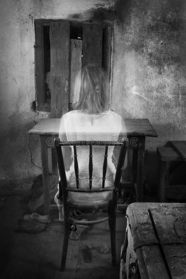 Horror girl in creepy old interior. Horror ghost girl in white dress in creepy old interior stock image