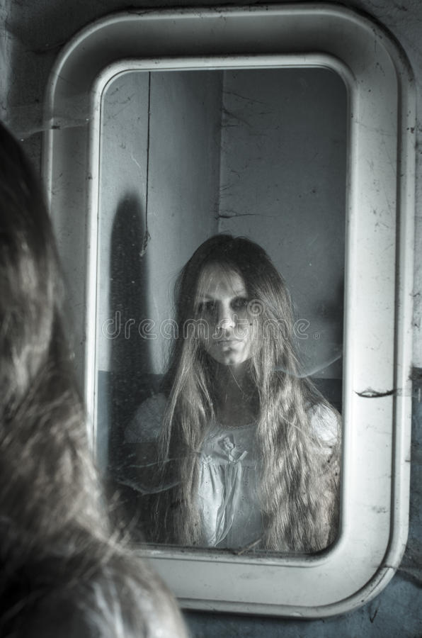Horror girl in the mirror stock images