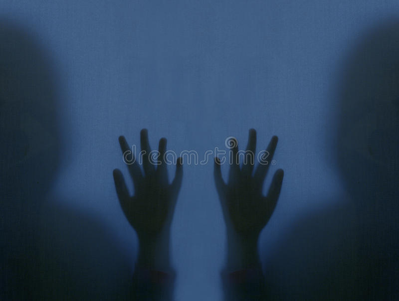 Horror hand. Diffused silhouette. stock images