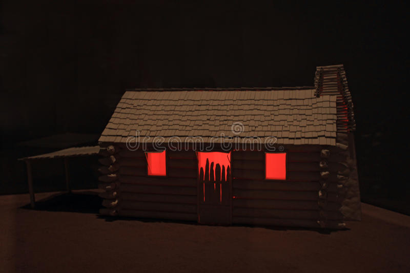 Horror house. Haunted house with red windows in in the countryside stock photo