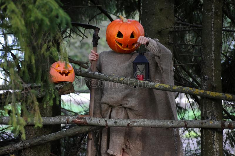 Download Horror Pumpkin With A Scythe Stock Photo