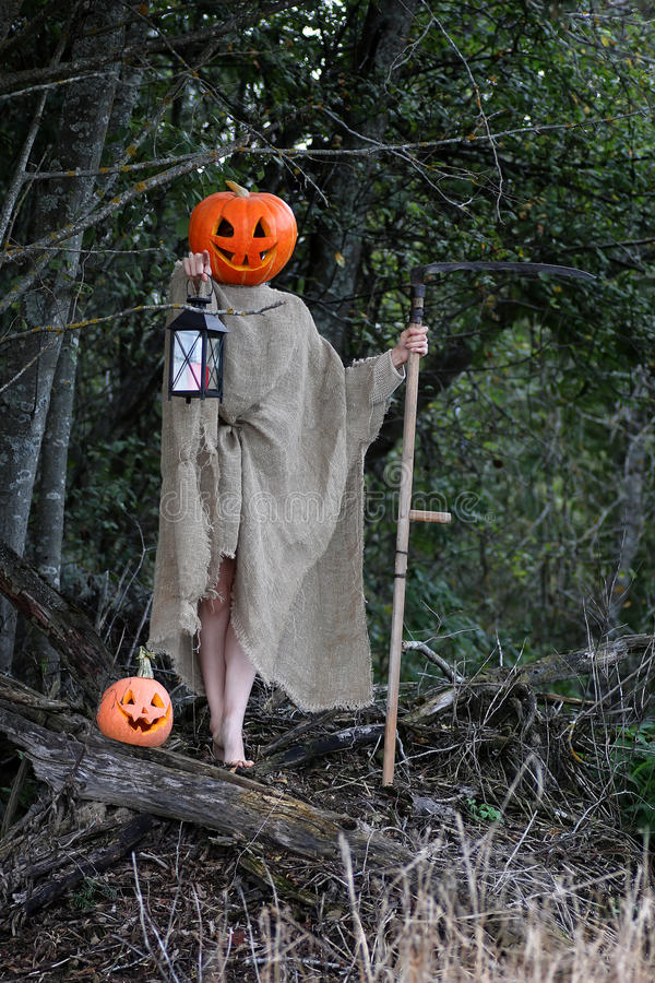 Download Horror Pumpkin With A Scythe Stock Image