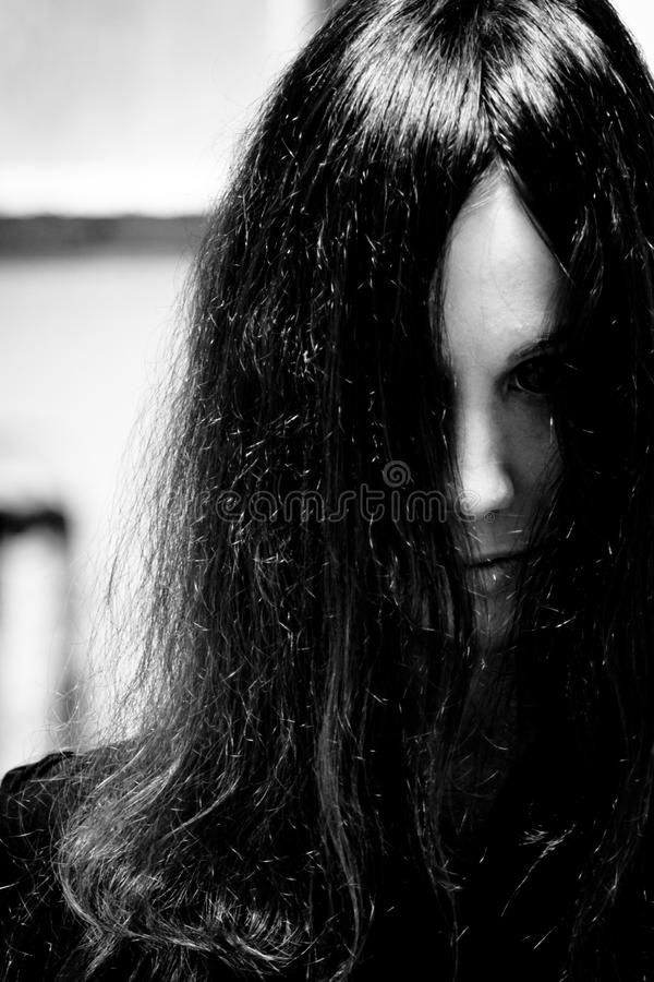 Horror scary woman. Closeup of female zombie face with colored eyes royalty free stock image