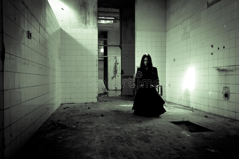Horror scary woman. Horror scene of a scary woman royalty free stock photo