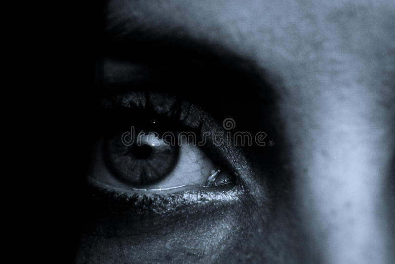 Horror scene: Female eye pupil. Horror scene of a scary woman royalty free stock photos