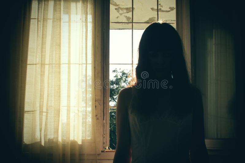 Horror scene of female silhouette royalty free stock images