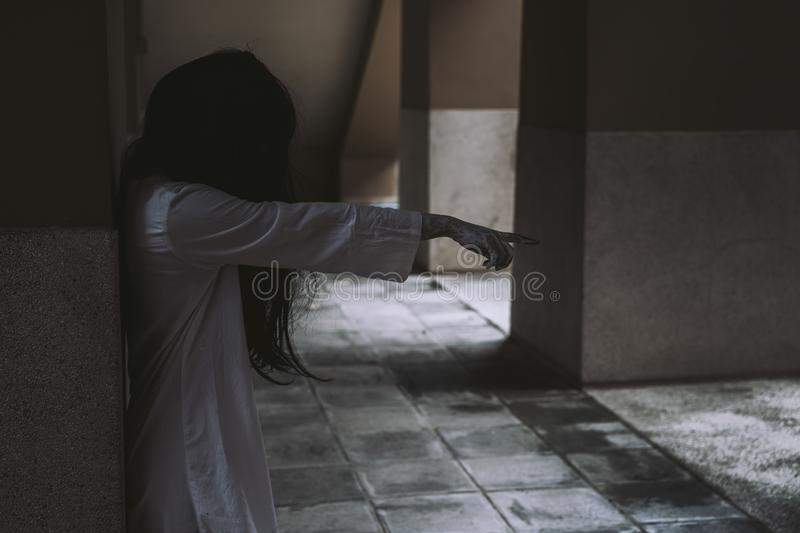 Horror scene of ghost woman death movie film halloween festival. In the dark house nightmare screaming on hell is monster devil girl or female dead characters royalty free stock images
