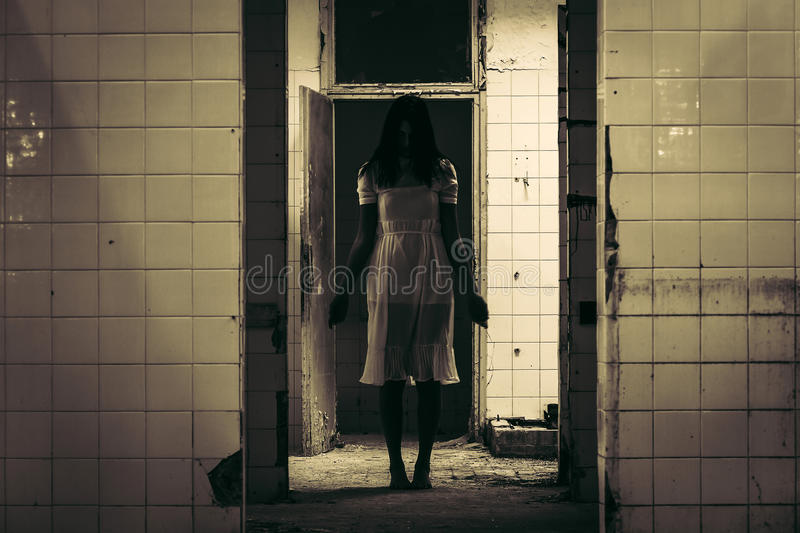 Horror scene of haunted woman. Horror scene of female ghost in the old abandoned building royalty free stock image