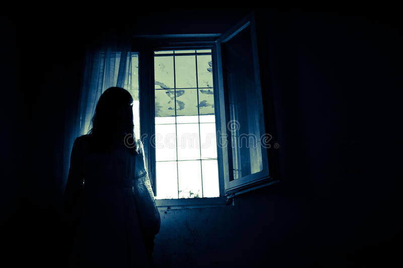 Horror Scene of a Scary Woman. Horror Scene of a Black Long Hair Woman royalty free stock photography