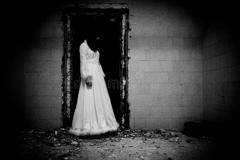 Horror Scene of a Scary Woman. Horror Scene of a Black Long Hair Woman in a Wedding Dress stock images