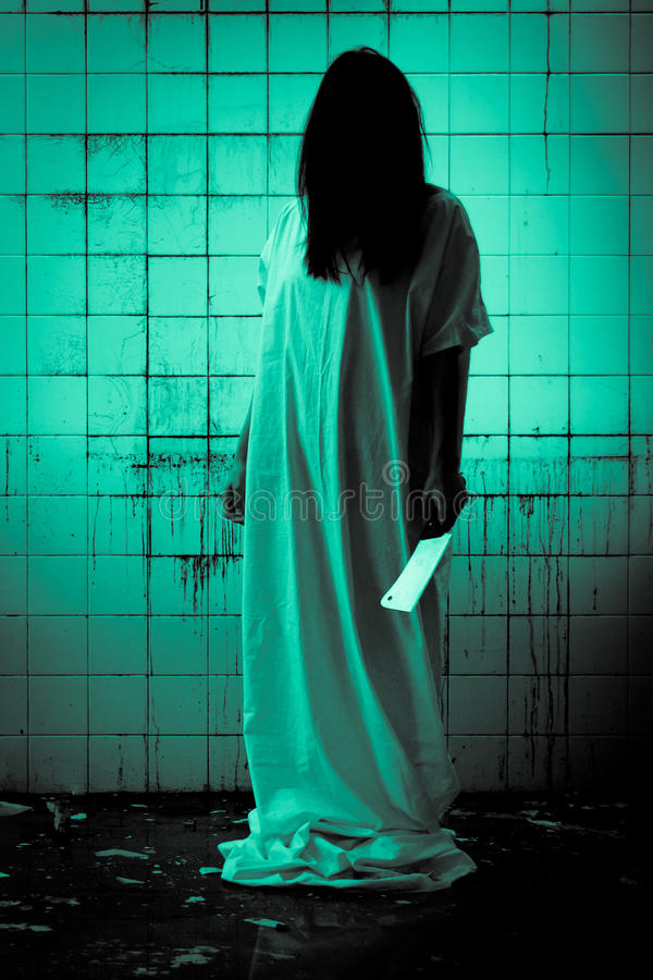 Horror Scene of a Scary Woman. Can be used for desktop wallpaper stock photography