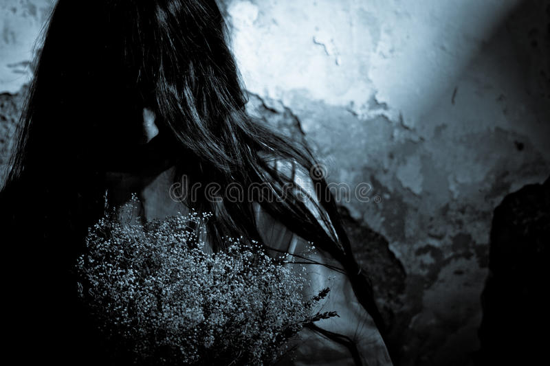 Mysterious girl. Horror Scene of a Scary Woman stock image