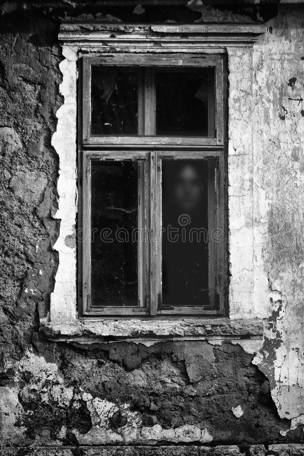 Horror scene of a scary woman. Ghost at the grunge window royalty free stock photos