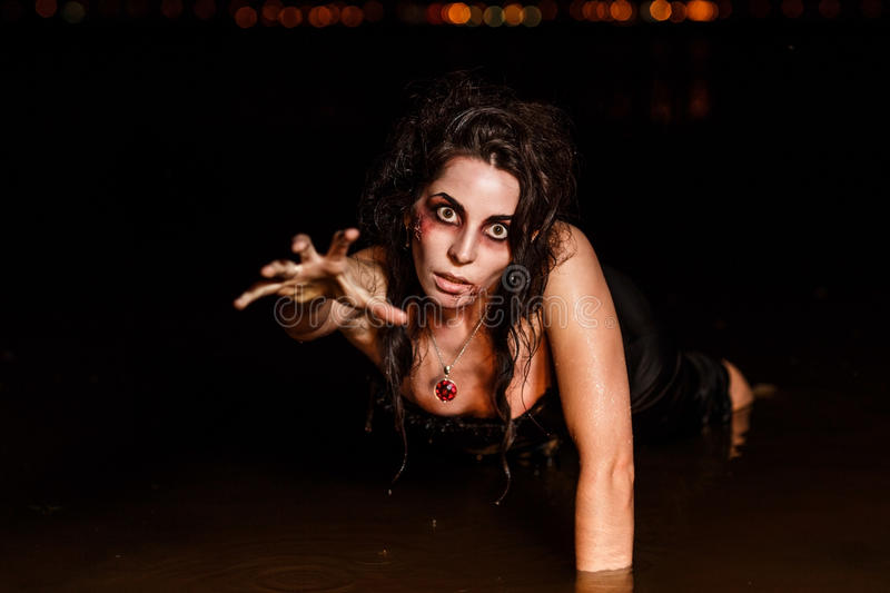 Horror Scene. The woman in the swamp royalty free stock photo