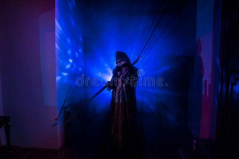 Horror silhouette of ghost inside dark room with mirror Scary halloween concept Silhouette of witch inside haunted house with fog stock photography
