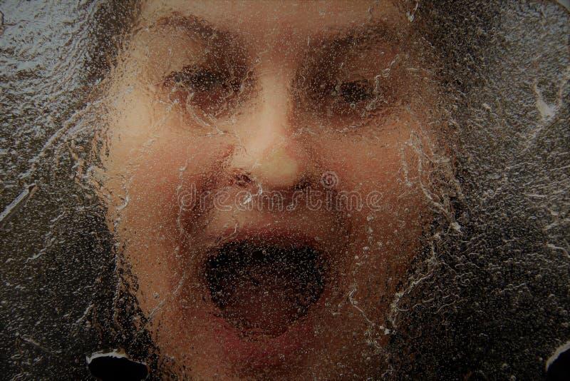 Horror twarz pod cienką warstwą lód zdjęcie royalty free