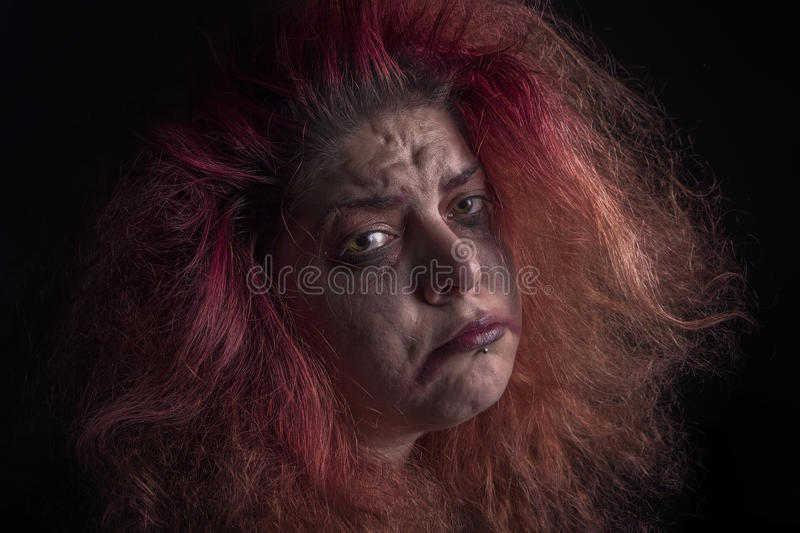 Horror woman is sad. Mad, deranged girl looking sad face stock photos