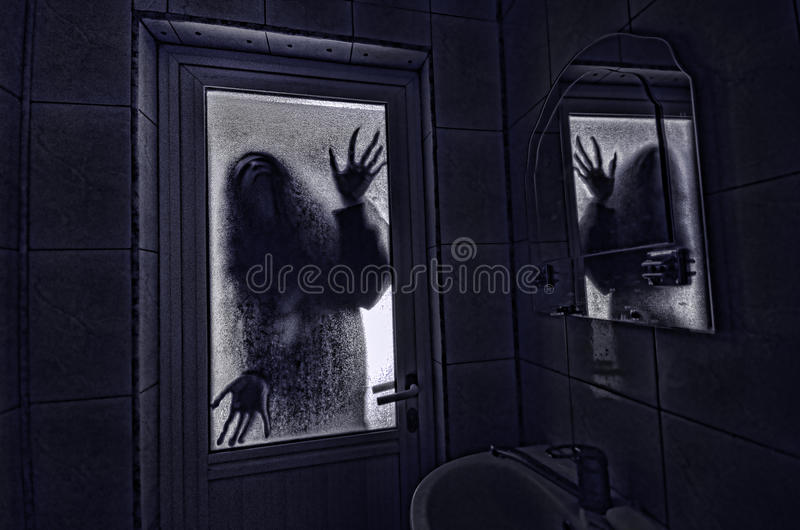 Horror woman in window wood hand hold cage scary scene halloween concept Blurred silhouette of witch royalty free stock photos