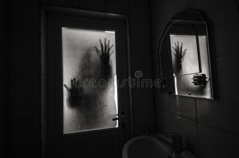 Horror woman in window wood hand hold cage scary scene halloween concept Blurred silhouette of witch. Horror woman in window wood hand hold cage scary scene stock photos