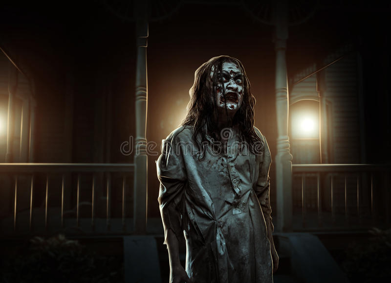 Horror zombie near the abandoned house. Halloween. royalty free stock photography