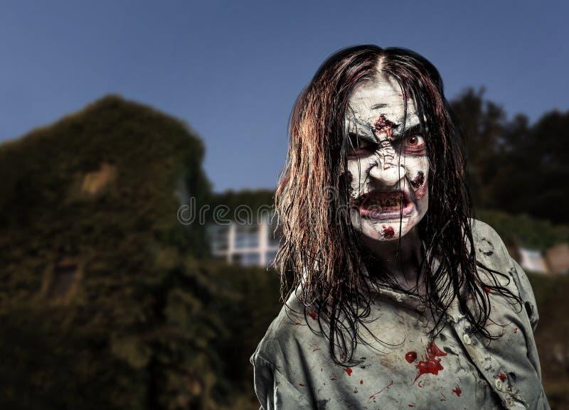 Horror zombie near the abandoned house. Halloween. stock photos