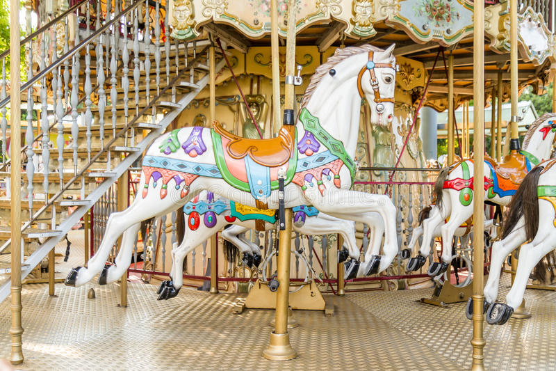Horse on a carousel at a fair royalty free stock photo