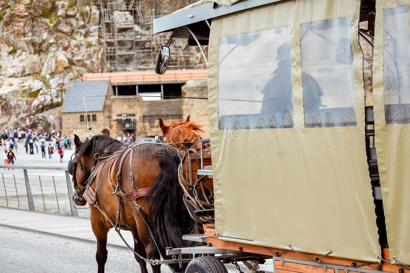 Horse carriage arriving at Mont Saint Michel, France royalty free stock images