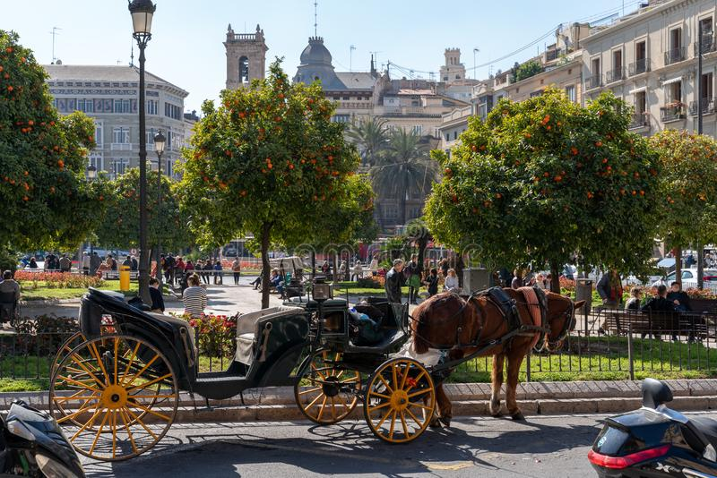 Horse and carriage for hire in Valencia Spain on February 25, 2019. Unidentified people. VALENCIA, SPAIN - FEBRUARY 25 : Horse and carriage for hire in Valencia royalty free stock images