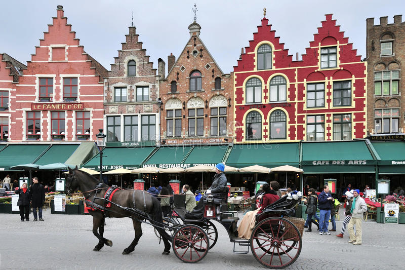 Brugge. Horse carriage on the main square Grote Markt in Brugge - Belgium stock image