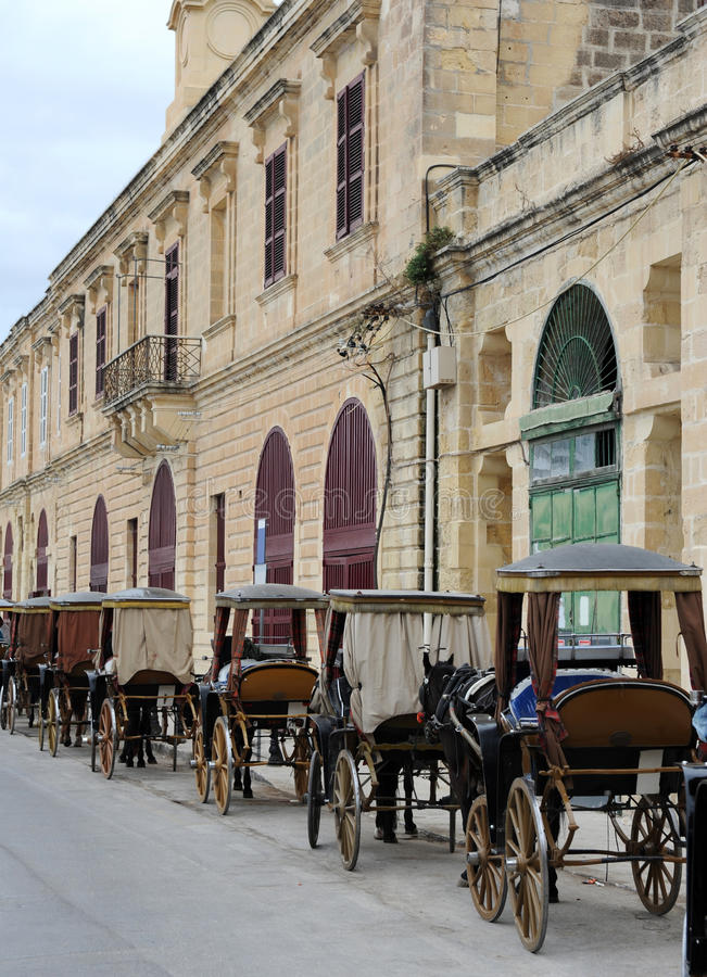 Horse Carts of Malta. Horse Carts Tour in Malta. They are waiting in the line for tourists royalty free stock photo