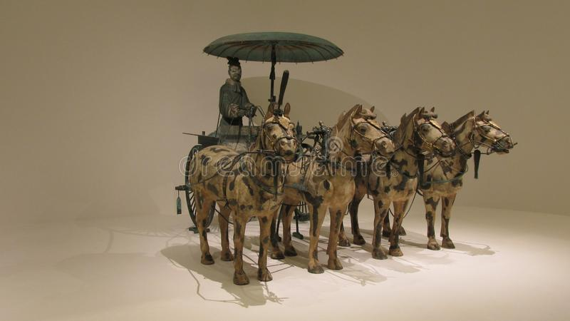Horse chariot made in bronze with gold and silver decoration royalty free stock photography