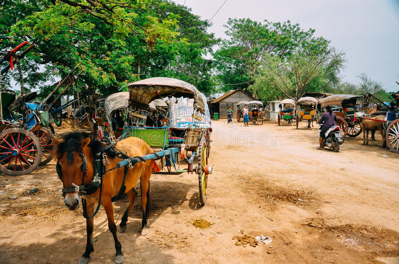 Horse and colorful buggy in Bagan. stock image