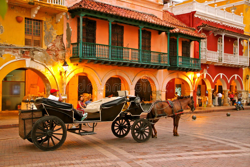 Horse drawn carriage, Plaza de los Coches, Cartagena. Horse drawn carriage waiting for tourists on Plaza de los Coches. Cartagena, Colombia royalty free stock photography