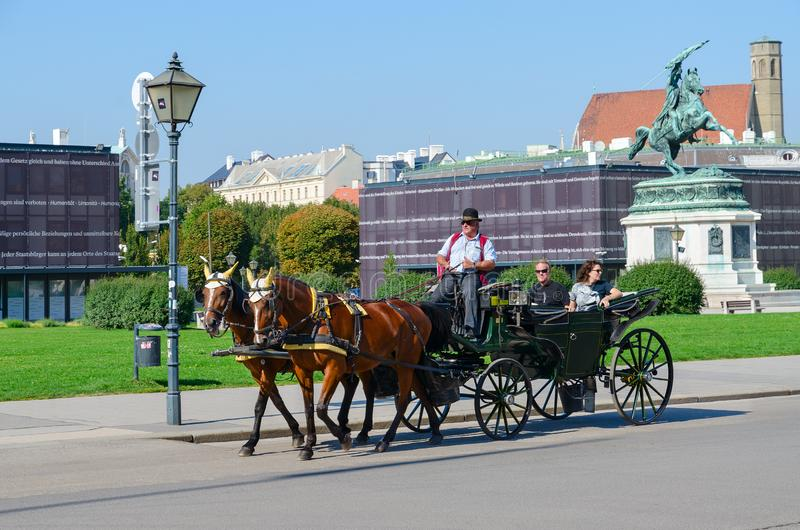 Horse-drawn carriage Viennese fiacre in historic center of city, Vienna, Austria stock photography