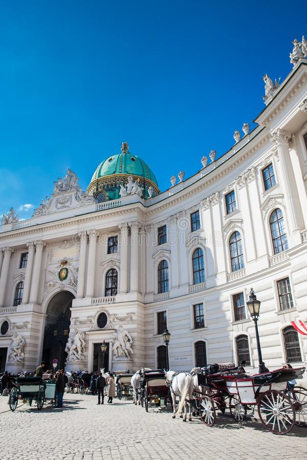 Horse-drawn carriages in front of the Hofburg Imperial Palace in Vienna stock image