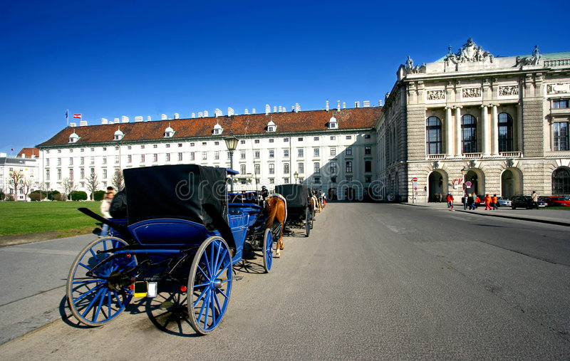 Horse drawn carriages in Hofburg, Vienna. royalty free stock images