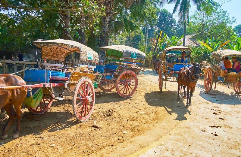 The horse-drawn carts, Ava. AVA, MYANMAR - FEBRUARY 21, 2018: The horse-drawn carts offer the tour around the ancient imperial capital of Burmese kingdoms, on royalty free stock image
