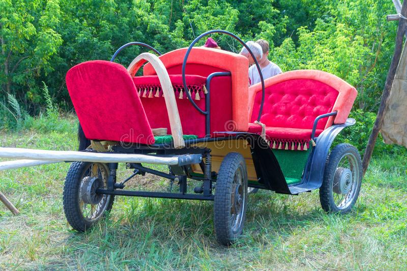 Horse-drawn four-wheeled open light carriage for the transport of passengers. royalty free stock photos