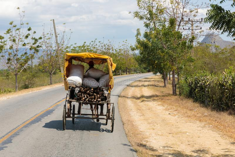 Horse drawn vehicle on a street in Cuba royalty free stock photography