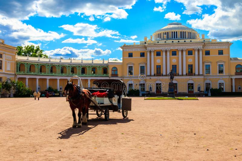 Horse-drawn wagon on a square at the Pavlovsk Palace in Pavlovsk, Russia royalty free stock images