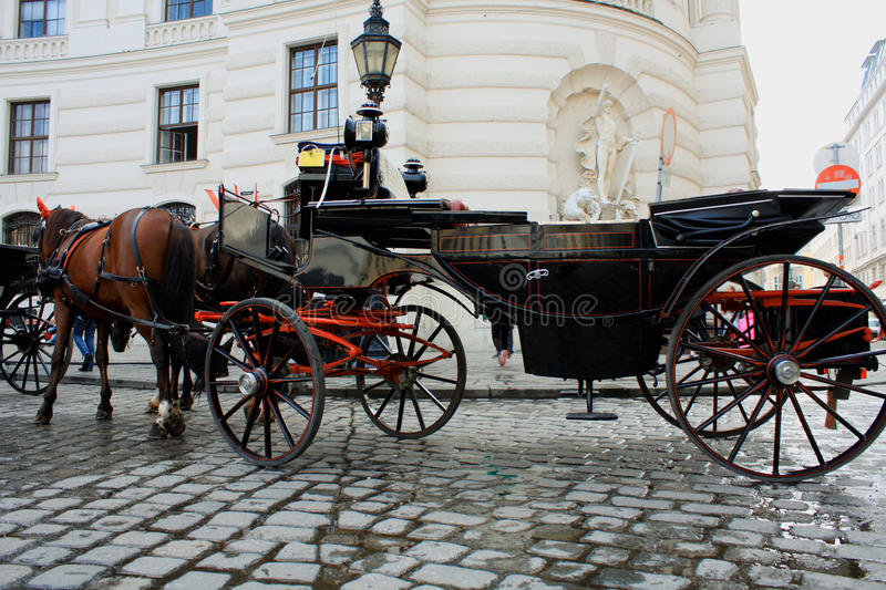 Horse-driven carriage at Hofburg palace, Vienna, Austria stock photography