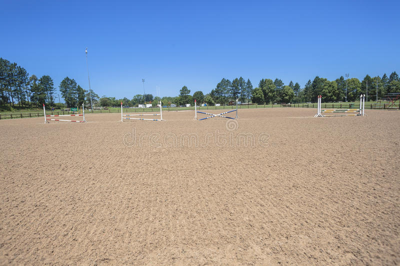 Horse Equestrian Arena. Sand surface set up for warm ups for rider and horse during a regional event competition at Shongweni grounds royalty free stock images