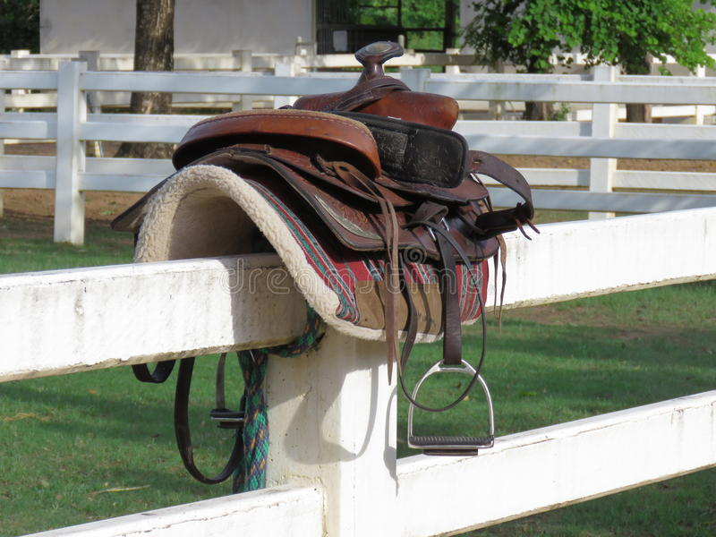 Horse equipment in the stable. Equipment for use in the riding of the horse, put it on backward stock photos