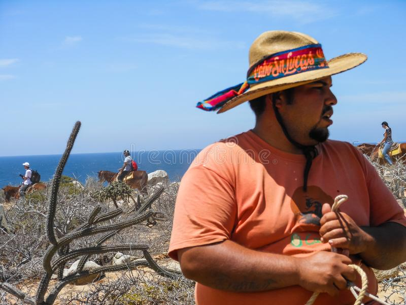 Horse farm owner escorting a group tour of horseback ringing in Cabo San Lucas, Baja California, Mexico, 2019.  stock image