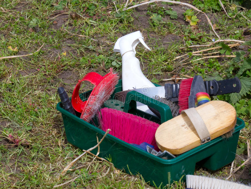 Horse Grooming Equipment. Carrying box with a selection of horse grooming equipment in it royalty free stock images