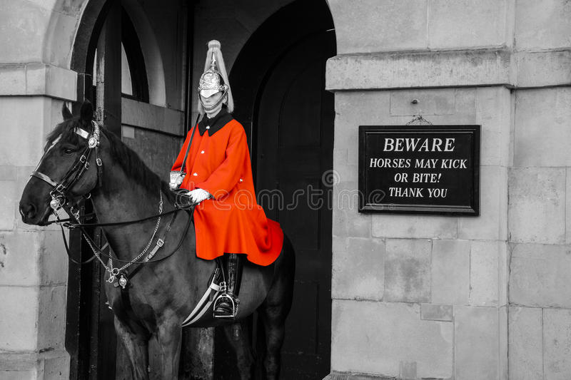 Horse Guard in Whitehall. Whitehall is a historic London street with runs from Parliament Square at Westminster to Trafalgar Square. The street is recognised as royalty free stock photography