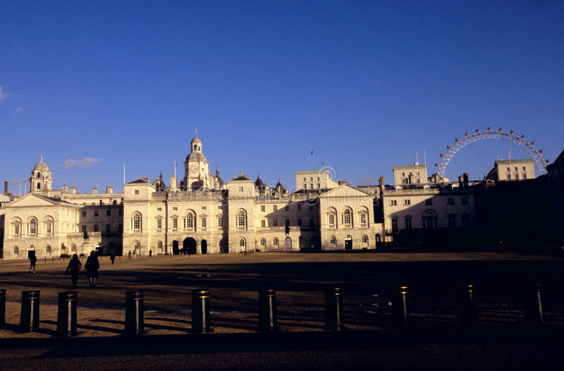 Horse Guards & the London Eye. The Horse Guards building and the London Eye wheel in London royalty free stock image